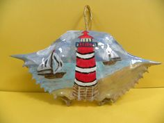 Lighthouse red,white, black with wood bottom and 2 sailboats painted on crab shell by Karenscrabs on Etsy Sailboat Painting, Seashell Painting, Seashell Art, Seashell Crafts, Crab Crafts, Diy Crafts, Christmas Crafts, Christmas Ornaments, Diy Ornaments