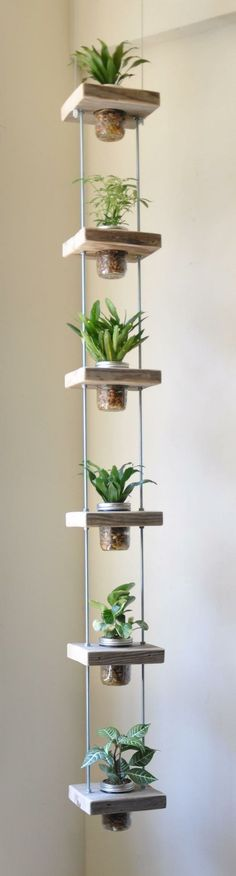 Hanging Herb Jar Garden - Don& have much space to grow your favorite plants? Try building a vertical garden like this one, hanging herb jar garden in you Vertical Planter, Vertical Gardens, Tiered Planter, Diy Vertical Garden, Small Herb Gardens, Vertical Farming, Vertical Storage, Hanging Herbs, Diy Hanging