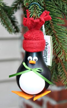 Penguin Christmas Tree Ornament - made from a recycled lightbulb (PA)