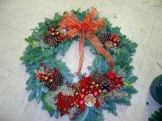 Decorated Oregon Wreath with pine cones. glitter stars, glass balls, ribbon and other holiday pics