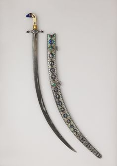 Shamshir Sword with Scabbard  Dated: early 19th century Culture: Indian Medium: steel, ivory, enamel, gold, wood, silver Measurements: length, 38 3/4 in. (98.43 cm) Classification: swords