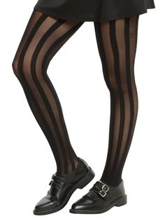 """<div>Add some dimension to your look without going too crazy. These black tights from Blackheart have sheer and opaque vertical stripes that will give the illusion of some extra height!</div><div><ul><li style=""""list-style-position: inside !important; list-style-type: disc !important"""">90% nylon; 10% spandex</li><li style=""""list-style-position: inside !important; list-style-type: disc !important"""">Wash cold; drip dr..."""