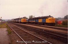Location:  Brockville, ON Subject:  Diesel locomotiveTrain, passenger Railway Name:  VIA RAIL CANADA INC. Date:  1982-05-19 Caption: Pulling out with the Ottawa section. Equipment Number: 6763