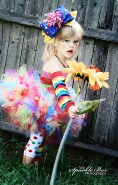 Handmade clown costume for Halloween including Petti Tutu, top, rainbow stripe and rainbow dot legwarmers along with a matching oversized bow. [oh yes and she is completely adorable.]