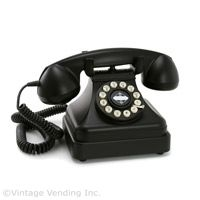 """This black phone was in every home in the 50's and 60's.  I loved using the rotary dial, it made a cool sound!  Remember """"party lines""""?"""
