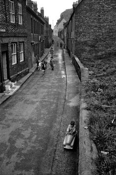 Child riding in toy car England 1960 Photo: Bruce Davidson