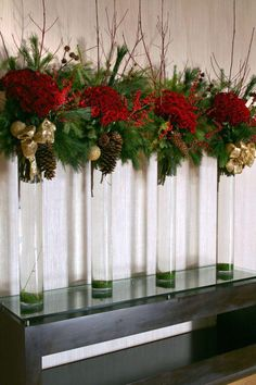 holiday displays in 2011 were a beautiful fusion between classic and modern styles.Hilton's holiday displays in 2011 were a beautiful fusion between classic and modern styles. Christmas Flower Arrangements, Holiday Centerpieces, Christmas Flowers, Christmas Tablescapes, Noel Christmas, Xmas Decorations, Flower Decorations, Christmas Wreaths, Classy Christmas