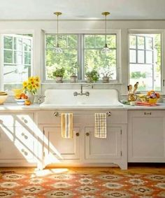 Love this farm sink and the entire look. Love the towel rack under the sink.