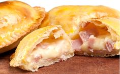 Ham and Cheese Empanadas: a pastry turnover filled with various savory fillings and baked or fried. In this case, were smothering leftover sweet baked ham with shredded cheddar cheese to make these wonderful, easily handheld lunchtime treats. Gourmet Recipes, Mexican Food Recipes, Cooking Recipes, Meat Recipes, Latin Food, Leftover Ham Recipes, Leftovers Recipes, Dinner Recipes, Homemade Ham