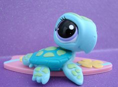 LPS sea turtle. but is it attached to the surf board like a macdonald's toy? remember those???