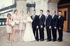 Bridesmaids in blush, Groomsmen in Navy suits with blush ties