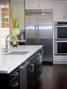 The choice of stainless steel appliances, including a refrigerator, dual oven and microwave, help to complete the contemporary look of the space.