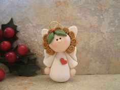 Angel with a Heart Christmas Ornament by countrycupboardclay Polymer Clay Princess, Polymer Clay Owl, Diy Fimo, Christmas Crafts, Christmas Decorations, Christmas Ornaments, Biscuit, Polymer Clay Christmas, Cute Clay