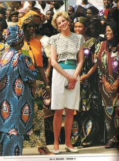 March 16, 1990: Princess Diana with Nigerian host, Mrs. Ibrahim Babaginda (orange jacket) during a visit to Lagos, Nigeria during the Royal tour.