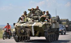 This photo shows the pro Separatist tanks lurking on the countryside near the MH 17 crash.