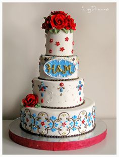 """Jeweled Indian Wedding Cake    I haven't made a wedding cake in about a year but this one was for a family friend of ours so it was quite special. Her colours were brown and blue, i then added the red to finish it off with roses. 4 tiers 12"""", 8"""", 6"""" & 4"""" with gumpaste decor and royal iced piping. Red is a big colour for an Indian bride so it worked nicely with her wedding outfit =)  Thanks for checking out my pics i really appreciate it =)"""