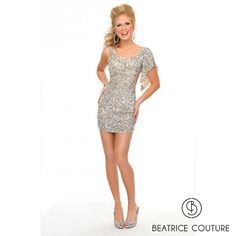 BB8920  The hand done sequins that cover this short stunning dress catch light and draw attention to the side cutout and deep V back.