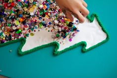 Make a Christmas tree shape out wool and pour glue into in, then use leftover sequins, buttons, glitter, etc to fill it in. You could do a star at the top too
