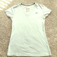 NIKE Dri-fit workout top Sea-foam green color, looks great with gray or black bottoms! Small marks on top as pictured but may come out with wash. Nike Tops Tees - Short Sleeve