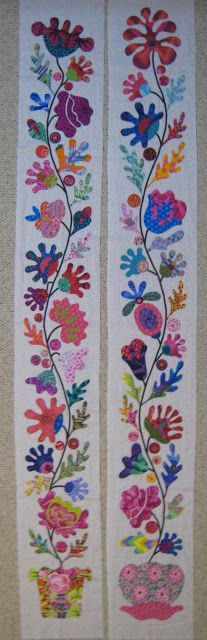 These are the side borders of Kim McLean's pattern Flower Garden. I would like to do this in strips - maybe five. I could repeat the pattern adding different flowers form this pattern and some of her other patterns. Maybe pieced strips dividing the flower strips. Just a thought.