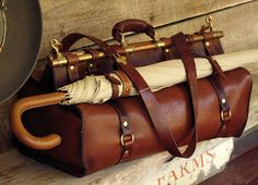 be prepared with vintage style umbrella and man bag - leather and metal - mens fashion accessories. I know it's a man bag but I LOVE! Mode Masculine, Masculine Style, Indiana Jones, Mode Style, Vintage Travel, Vintage Safari, Swagg, Retro, Travel Style