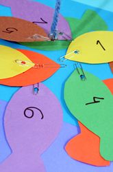 "Play the fish for numbers game. What you need: Paper cut into a fish shape, hole punch, and paper clip. Attach a string with a magnet at the end to a dowel. Tell you child, ""I'm hungry for a number 4 fish!"" Vary the game by using letters or site words"