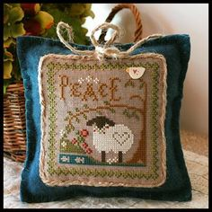 Little House Needleworks  Her famous sheep...I do love sheep.