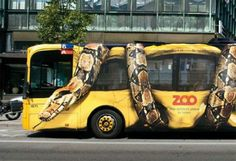 Bus ad - Boa constrictor optical illusion to advertise the zoo.