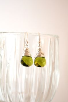 """1004- Sterling Silver Wire Wrapped Faceted Olivine Swarovski Crystal Briolette Earrings $22 Description: Rich and beautiful and ready for Autumn elegance!! These earrings sparkle with every move!! Wire wrapped in Sterling silver and gracefully dangle from Sterling silver French ear wires. These earrings measure approximately 1"""" from top of ear wire."""