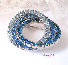 Vintage Brooch Blue Rhinestone Tri Circle Pin silver tone by Vintage55 on Etsy https://www.etsy.com/listing/193687822/vintage-brooch-blue-rhinestone-tri