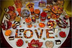 """So we must do a candy bar! I pinned this one because I like the """"love"""" dishes- but I also love the different size glass jars too- so we'll need both! ;))"""