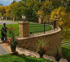 Wrought iron on top of the retaining wall