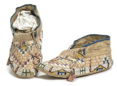 A pair of Sioux beaded and quilled moccasins
