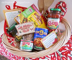 Mexican food inspired basket:        Salsa (lots of varieties)      Taco Shells      Tostadas      Re-fried Beans      Green Chiles      Jalapenos      Spices      Cooking Utensils      Recipes      I found some great potholders and an apron with a chile pepper pattern