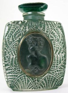 Google Image Result for http://www.ebaycollectors.com/wp-content/uploads/2010/10/Lalique-1920s-Perfume-Bottle-Cameo.jpg