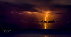 Golden bolt - While the city was asleep, a marvelous show was going on at sea. These electric arms were stretching out from the cloud to reach the infinity.