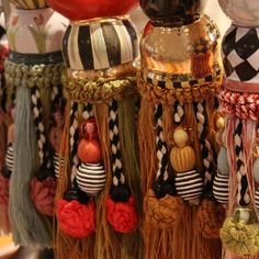 These tassels from mackenzie childs are colorful and unique and the handpainted ceramic centers make them true works of art.
