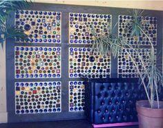 A wall built of bottles - that's a lotta wine! #DIY Recycling #Bottles
