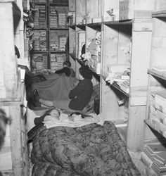 Brandt, Bill -- Londoners spending the night in the basement of a book store in Bloomsbury, London during the Blitz of 1940.