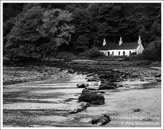 An isolated house on a beach near Criccieth in North Wales
