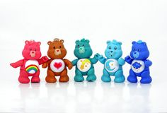 The Care Bears!  I had the Cheer Bear (rainbow on tummy) and my sister had Funshine Bear (yellow with sun on tummy).
