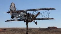 Shown is Joe Smith's biplane creation he made of horseshoes at his home near Leedey.   David McDaniel - The Oklahoman