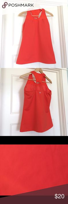 Athletes tank EUC Workout tank with breathable mesh in stem of Racer back and above molded (and removable) cups. There is an extremely slight smudge on front (pictured) that looks like pencil? You might not notice but I have to report. Lovely tangerine orange color! Athleta Tops Tank Tops