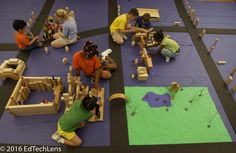 Mixed-age students work together on an integrated curriculum project building a…