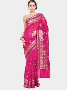 Look pretty and pink by draping this saree with a blue silk sleeveless blouse. It is best punctuated with a set of oxidized jewelry and a pair of matching stilettos.