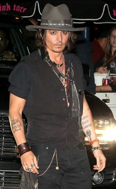 Johnny Depp at Steven Tyler's party at Pink Taco restaurant Los Angeles in August 2012