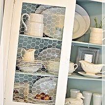 Replacing Glass in a Cabinet with Chicken Wire. Inside painted Duck Egg Blue. Beautiful.