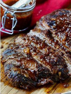 Oven-Barbecued Beef Brisket recipe from Cook's Illustrated. The best brisket cooked in the oven you will ever taste. Wrapped in bacon for smokiness and slow cooked. A few minutes under the broiler gives the outside a nice char. Beef Brisket Recipes, Bbq Brisket, Smoked Beef Brisket, Bbq Beef, Pork Recipes, Cooker Recipes, Barbecue, Mexican Brisket Recipe, Slow Cooked Beef