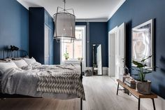 Bedroom with dark blue walls
