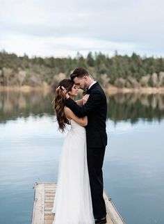 It was just these two (and a talented team of vendors) in the woods and on a canoe in this beautiful winter lakeside elopement! We love the rustic, slightly mysterious setting.